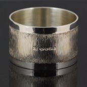 Silver napkin ring with bark effect decoration