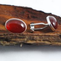 Silver cufflinks set with carnelian